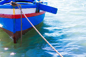 Sunlit Blue and Red Mediterranean Fishing Boat, Mooring Rope