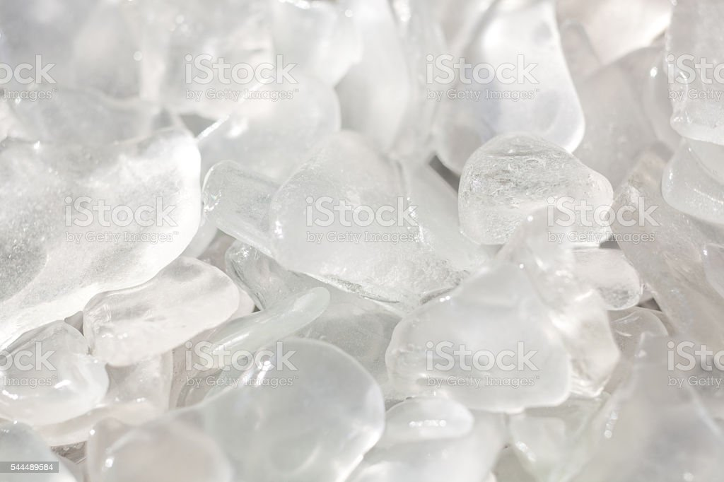 Sunlit Clear Fragments of Beach Glass stock photo
