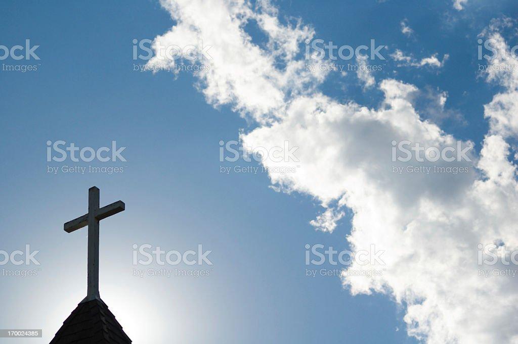 Sunlit Cross and Steeple stock photo