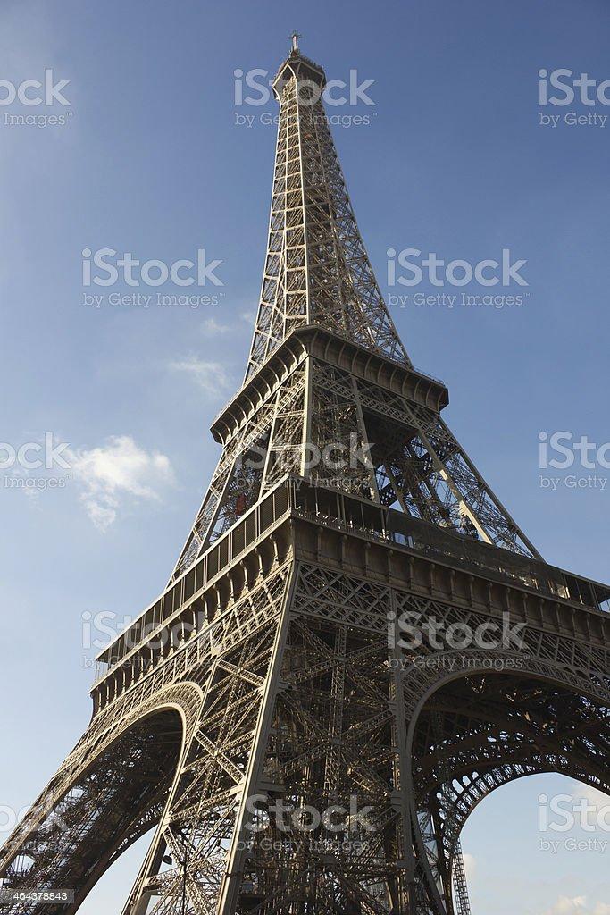 sunlit Eiffel Tower, Paris, against blue sky royalty-free stock photo