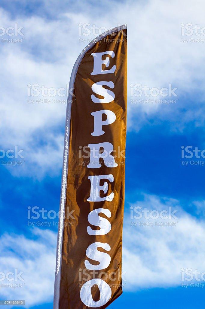 Sunlit 'ESPRESSO' Banner Against Blue Cloudy Sky stock photo