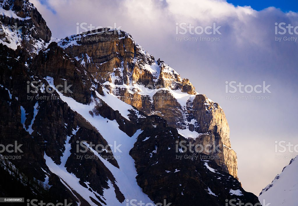 Sunlit mountain peak, Canadian Rockies stock photo