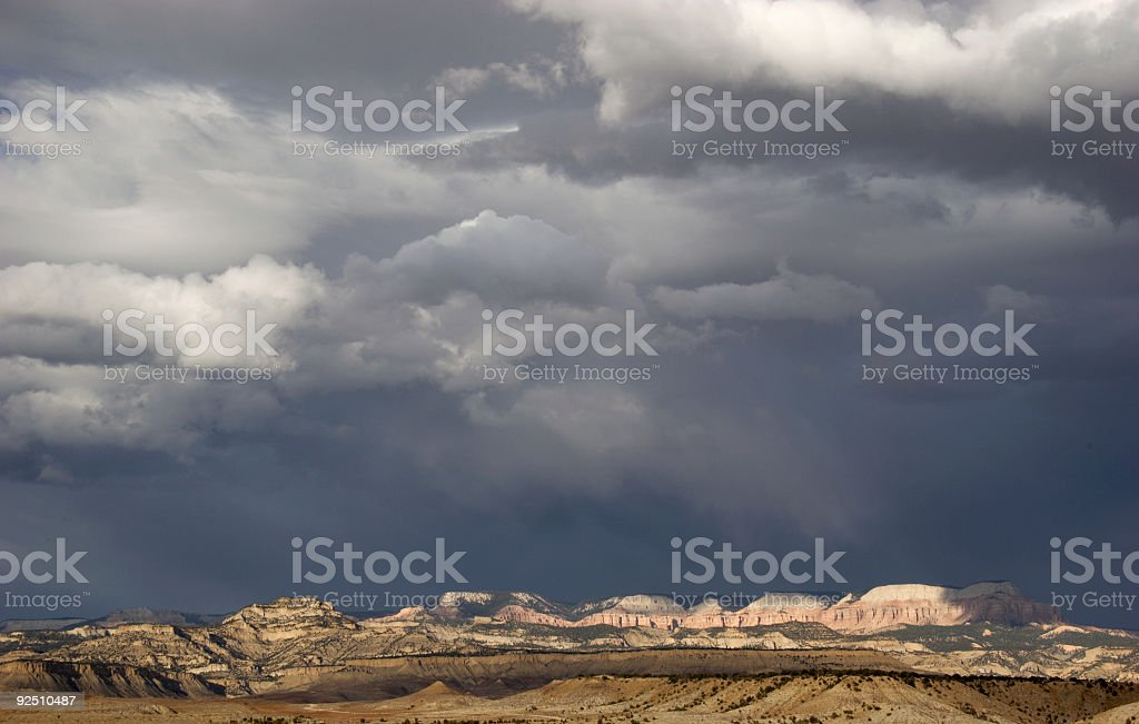 Sunlit Mountains Against Stormy Sky royalty-free stock photo