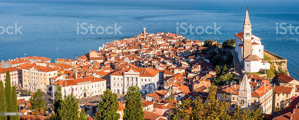 Sunlit Old Town of Piran in the Morning. stock photo