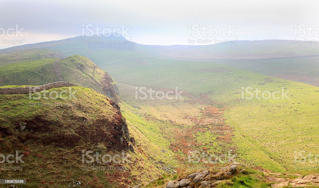 sunlit rocky crags in english  valley near Hadrians wall stock photo