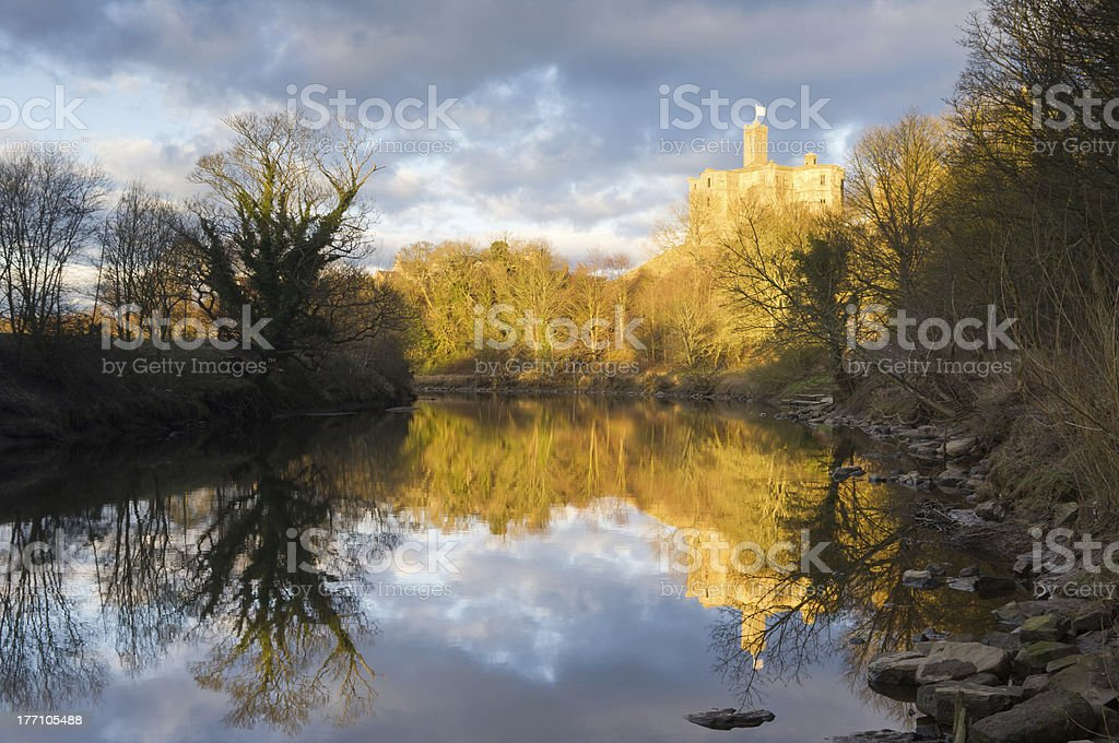 Sunlit Warkworth Castle stock photo