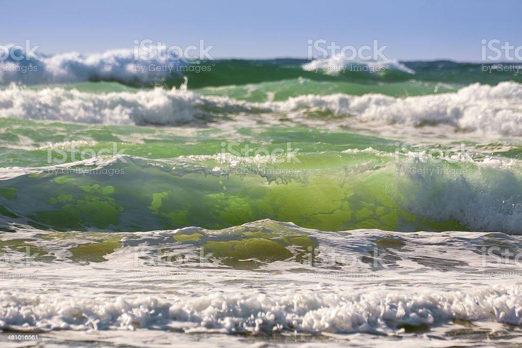 Sunlit Waves Crashing on a Cornish Beach stock photo