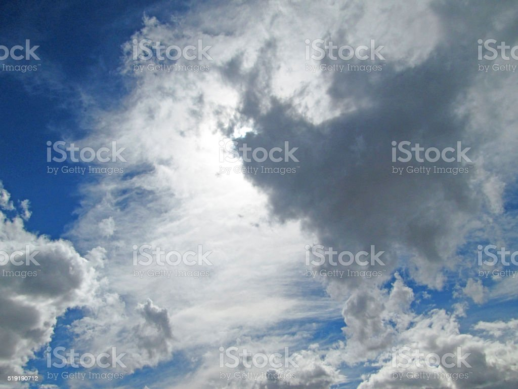 Sunlit wispy clouds stock photo
