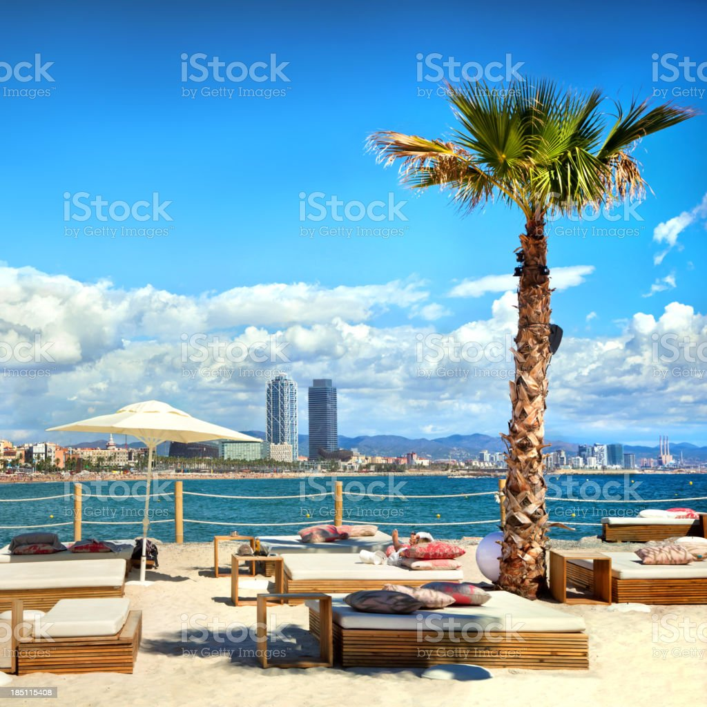 Sunloungers on beach in Barcelona, Spain royalty-free stock photo