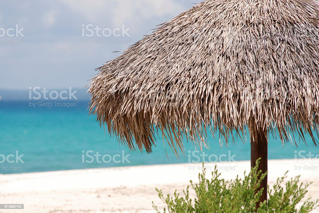 sunning screen on a white beach (1 Dollar Image) royalty-free stock photo