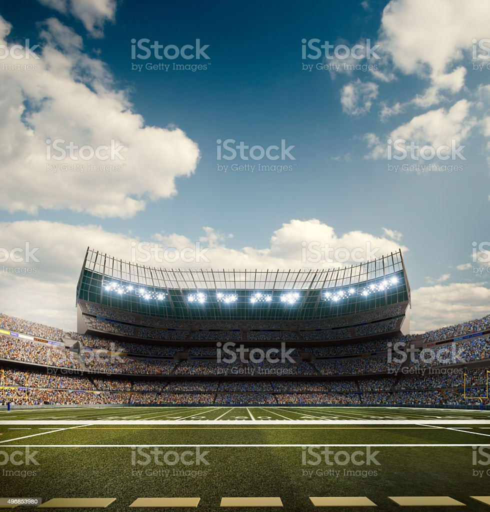 A wide angle panoramic image of a outdoor american football stadium...