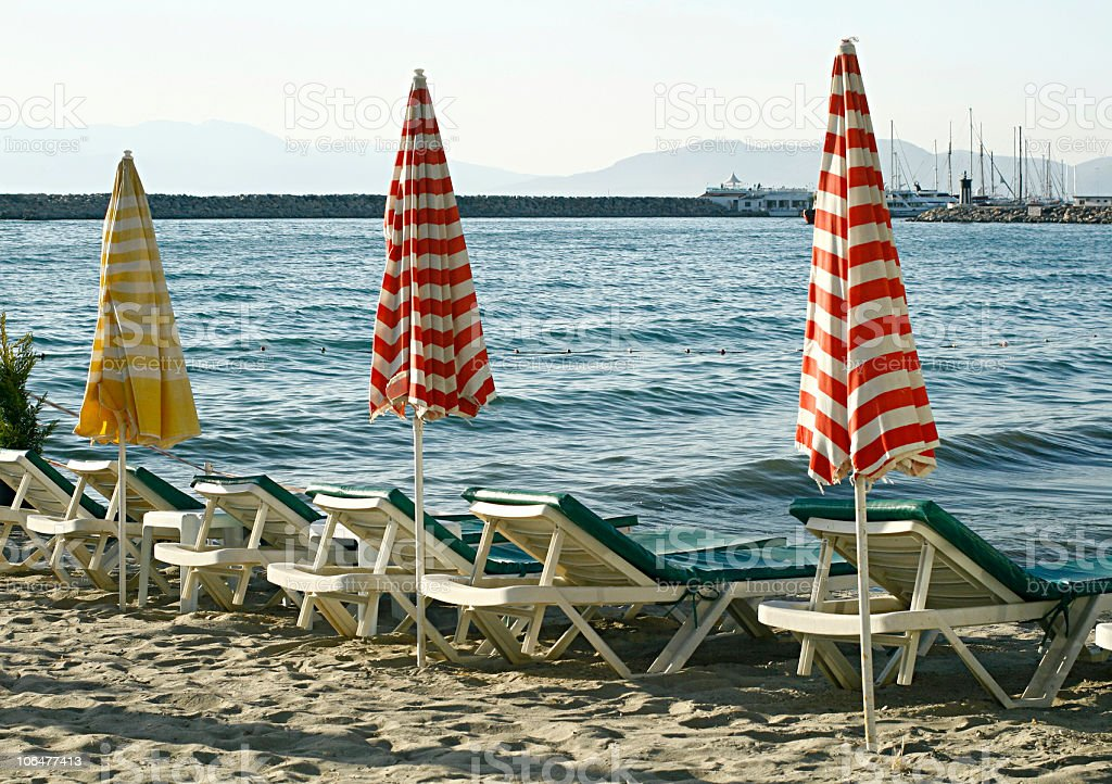 Sunny beach and beach-chairs royalty-free stock photo