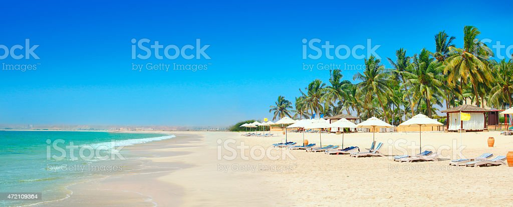 Sunny beach in Salalah Oman stock photo