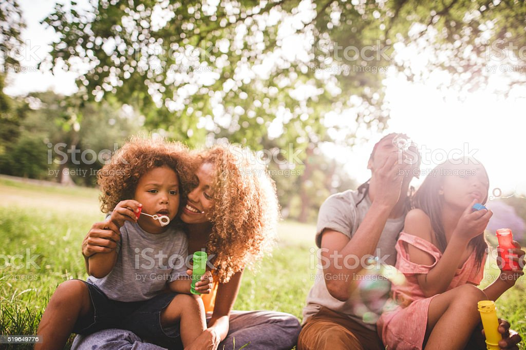 Sunny bright moment with a adorable african-american family stock photo