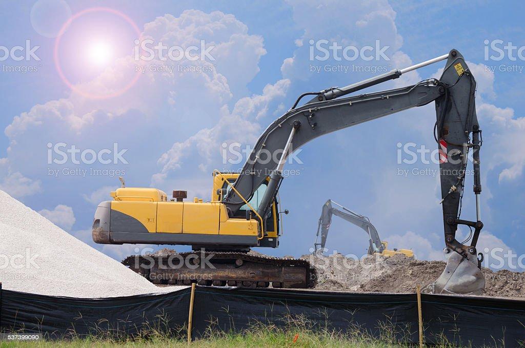 Sunny bulldozers construction site work digging stock photo