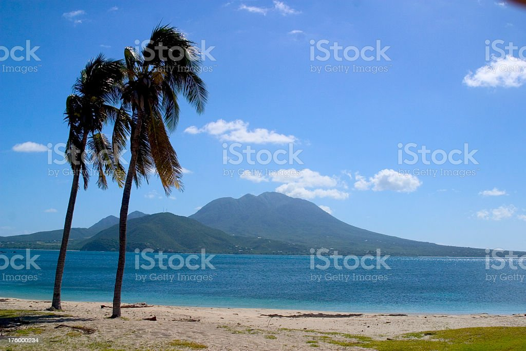 A sunny cloudy day in Nevis next to the ocean stock photo