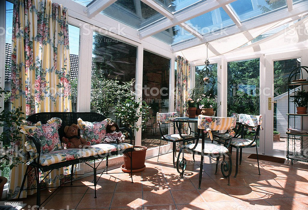 A sunny conservatory with garden furniture stock photo
