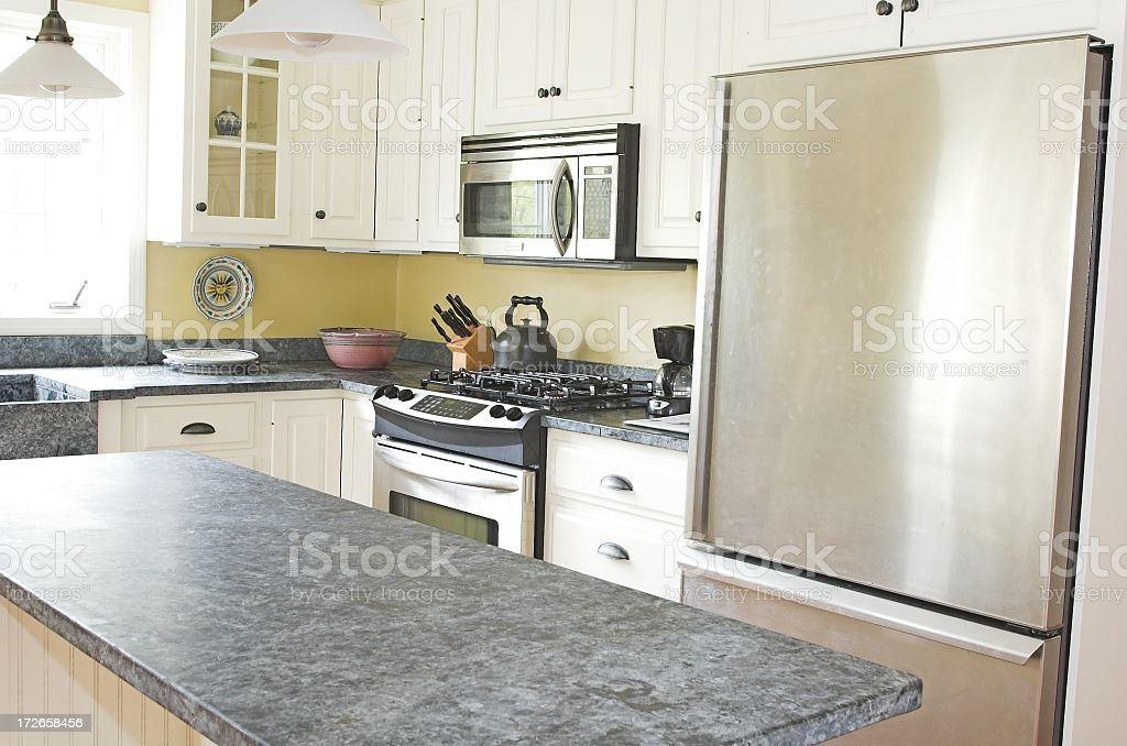 Sunny country kitchen with stone counter and stainless steel royalty-free stock photo