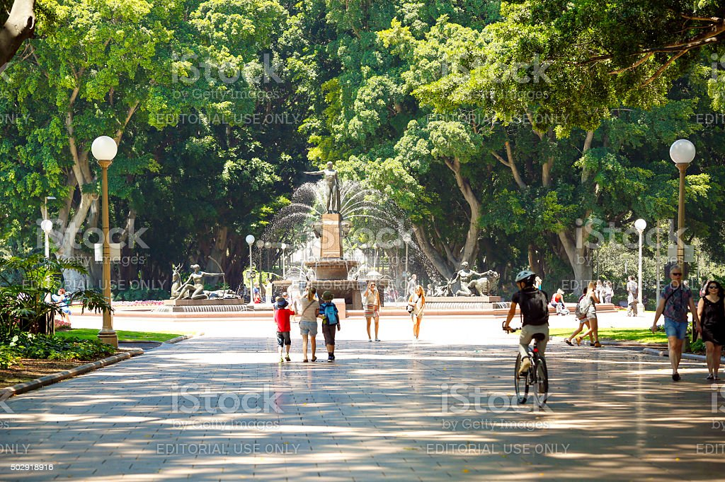Sunny day in the park with people, tourist and sightseers stock photo