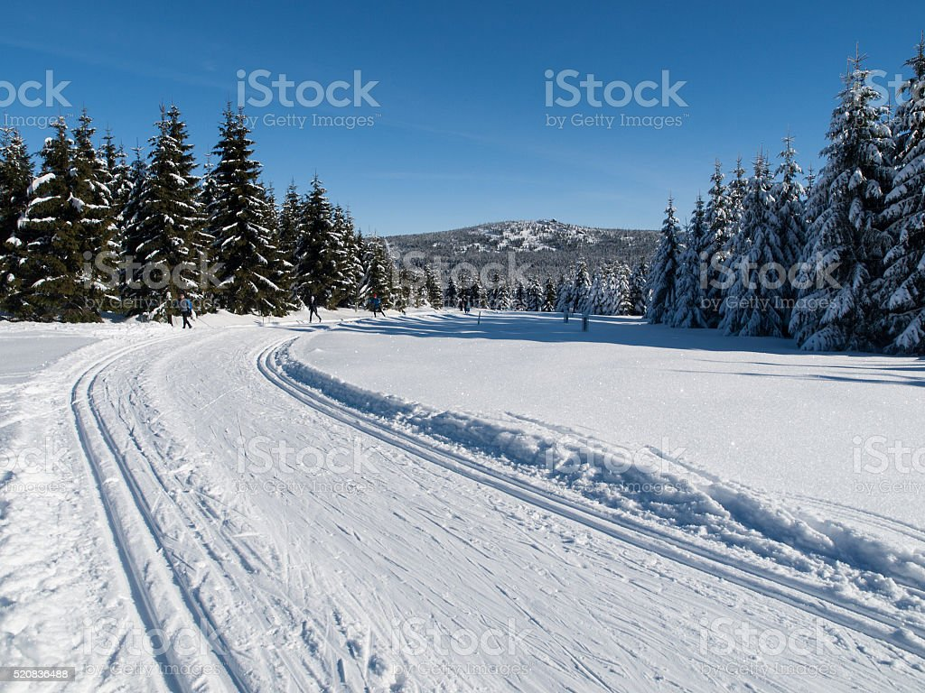 Sunny day on winter mountains with groomed cross-country trails stock photo