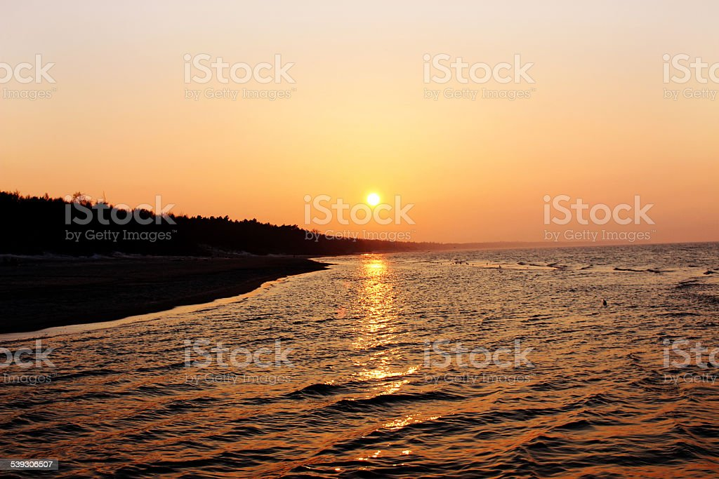 Sunny evening at baltic sea beach stock photo