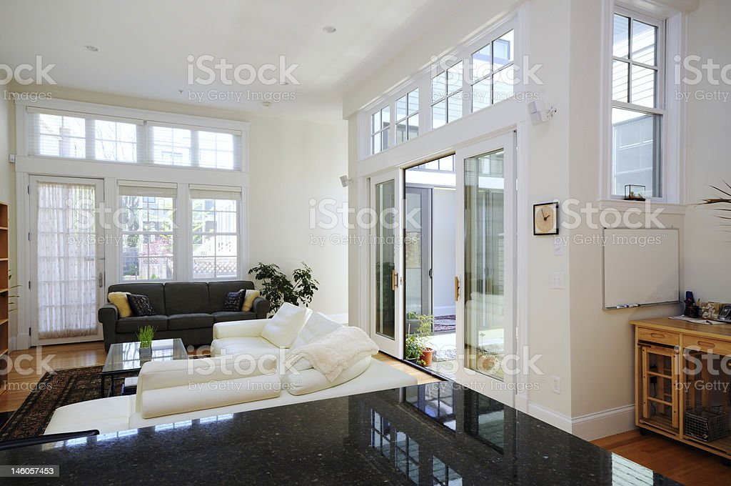 Sunny home interior of open plan apartment stock photo