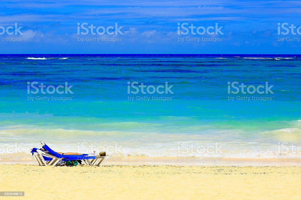 Sunny Idyllic Sandy caribbean beach at sunrise stock photo