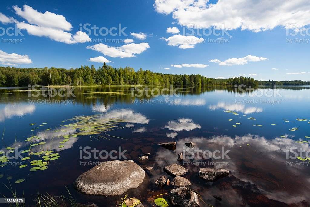 Sunny lake landscape from finland stock photo