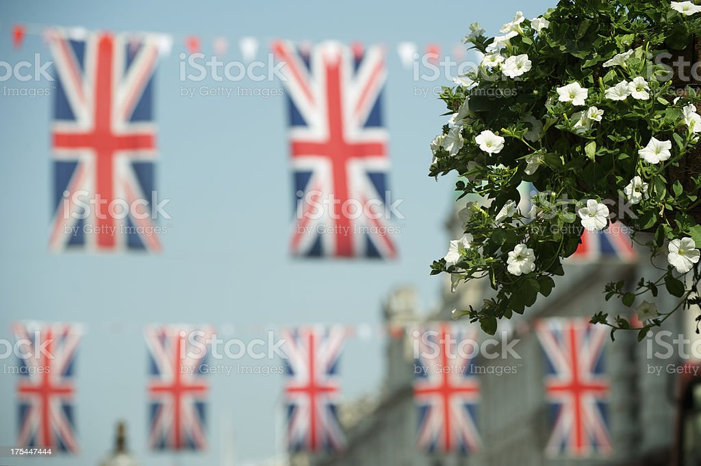 Sunny London Street with Plant and Union Jack Flags stock photo