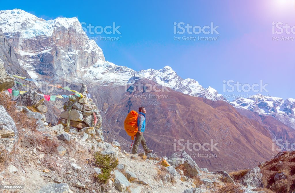 Sunny Mountain View and Nepalese Mountain Guide staying on Footpath stock photo