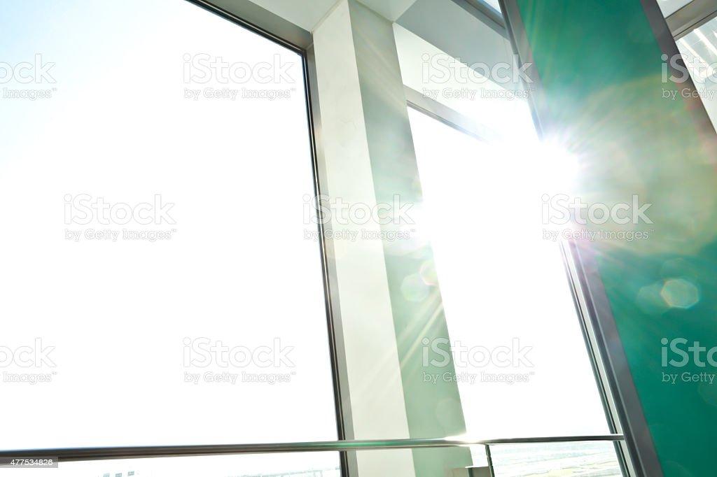 Sunny on modern glass office windows building interior corridor stock photo