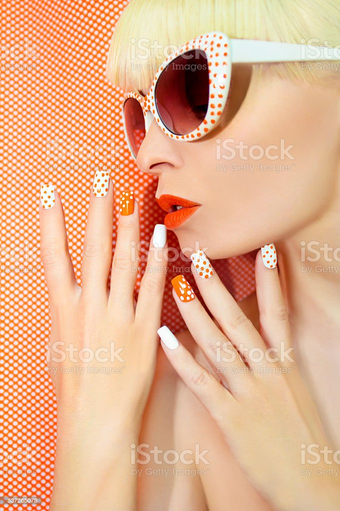 Sunny orange manicure and makeup. stock photo