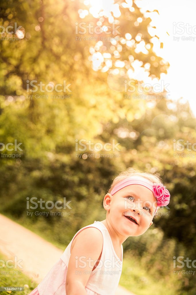 Sunny picture of smiling baby in park royalty-free stock photo