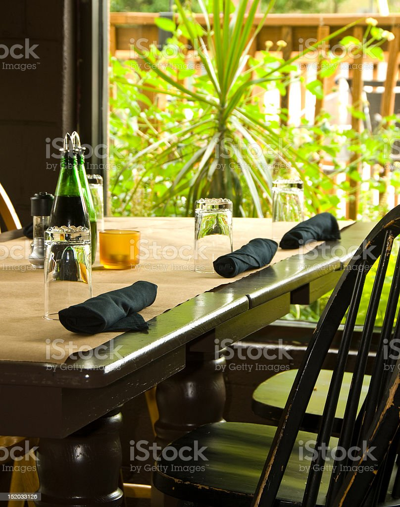 Sunny restaurant table royalty-free stock photo