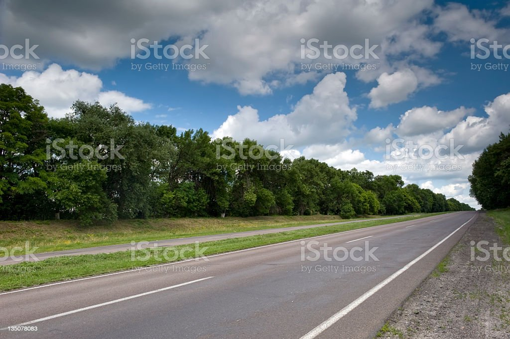 Sunny road between cities stock photo