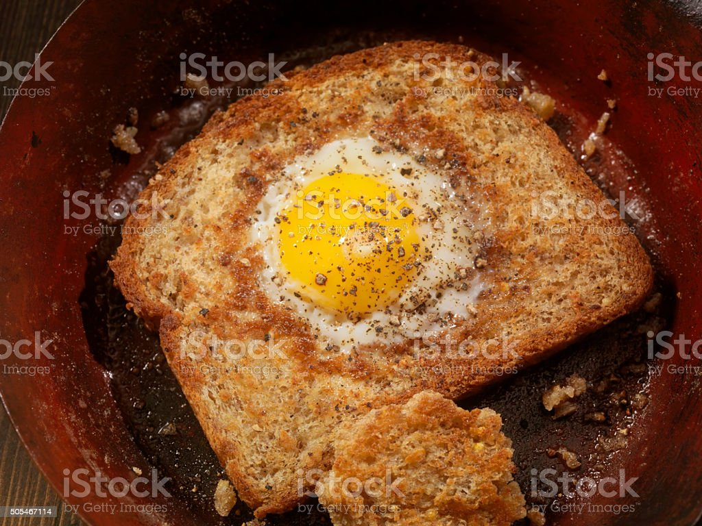 Sunny side up Egg in a hole with Bacon stock photo