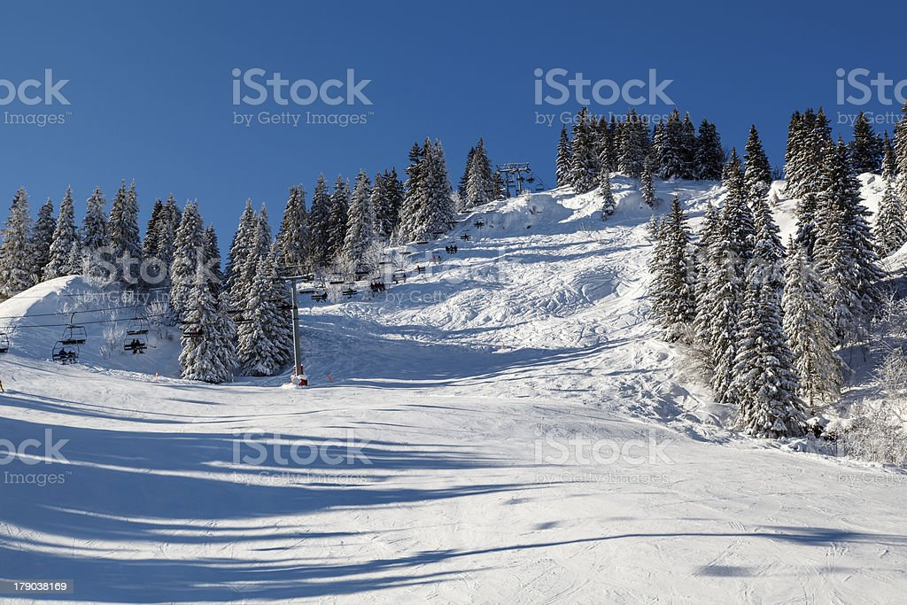 Sunny Ski Slope and Lift near Megeve in French Alps royalty-free stock photo