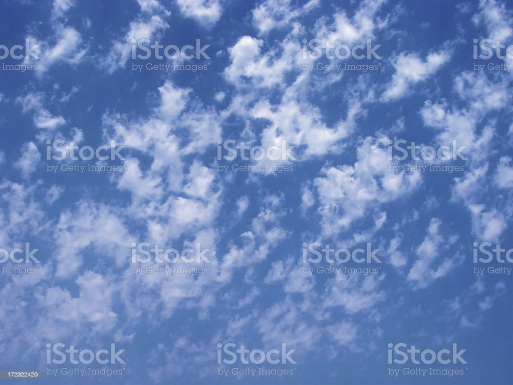 sunny sky background with fluffy white clouds stock photo