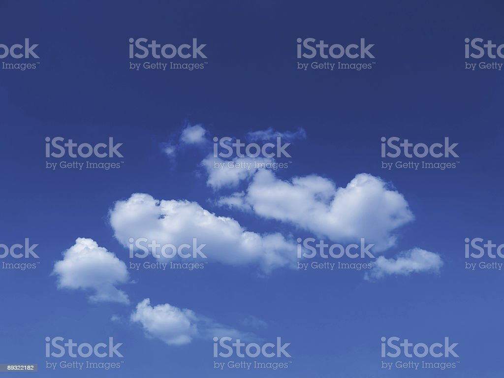 sunny sky background with fluffy white cumulus clouds stock photo