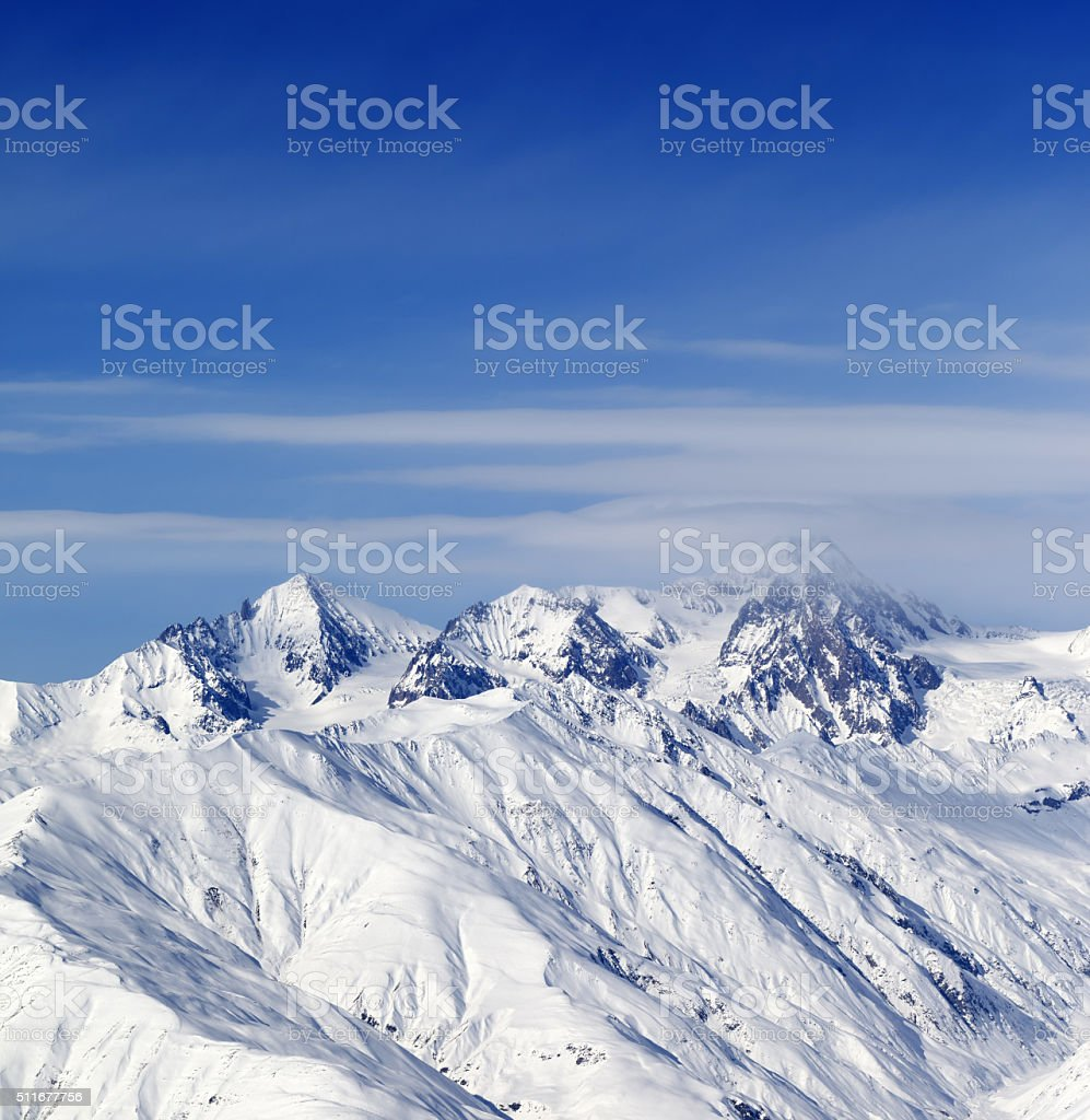 Sunny slopes of winter mountains stock photo