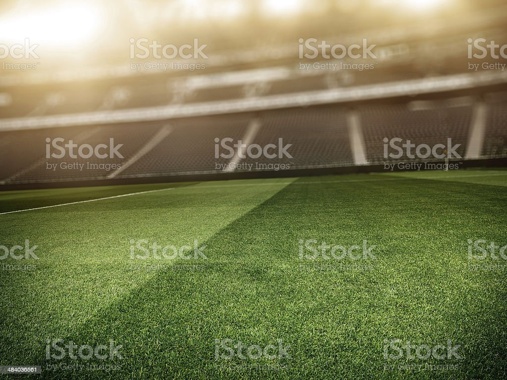 Sunny soccer stadium background stock photo