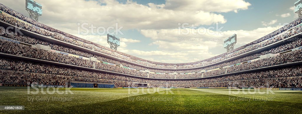 Sunny soccer stadium panorama stock photo