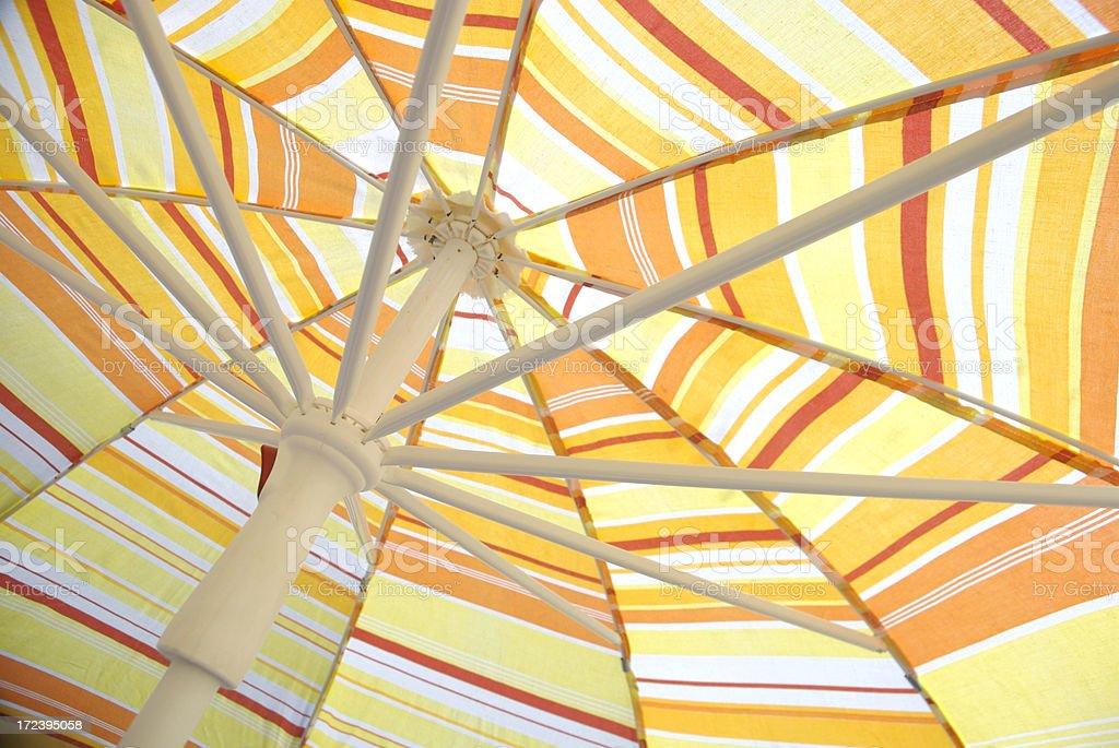 Sunny Stripe Beach Umbrella Parasol in Yellow and Orange royalty-free stock photo