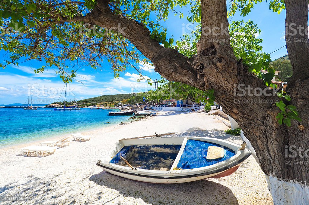 Sunny summer beach in Greece with sun beds and small stock photo
