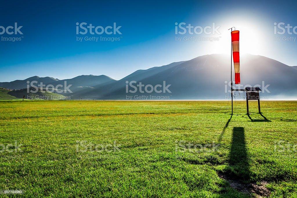 Sunny sunrise in the valley near Castelluccio, Umbria, Italy stock photo