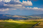 Sunny Tuscany landscape - beautiful hills and sky with clouds