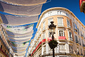 Sunny view of Larios street in Malaga, Andalusia province, Spain.