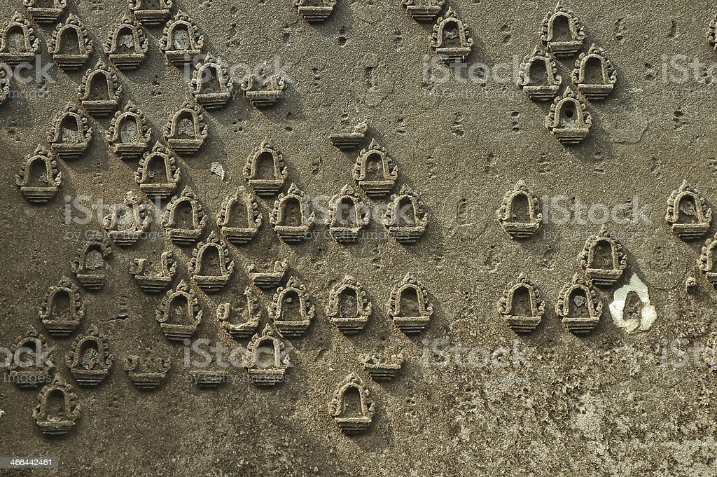Sunny Wall of Buddha amulets, Underwater temple in Sangkhlaburi Thailand royalty-free stock photo