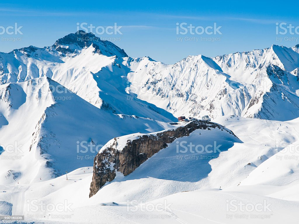 Sunny winter day in alpine ski resort stock photo