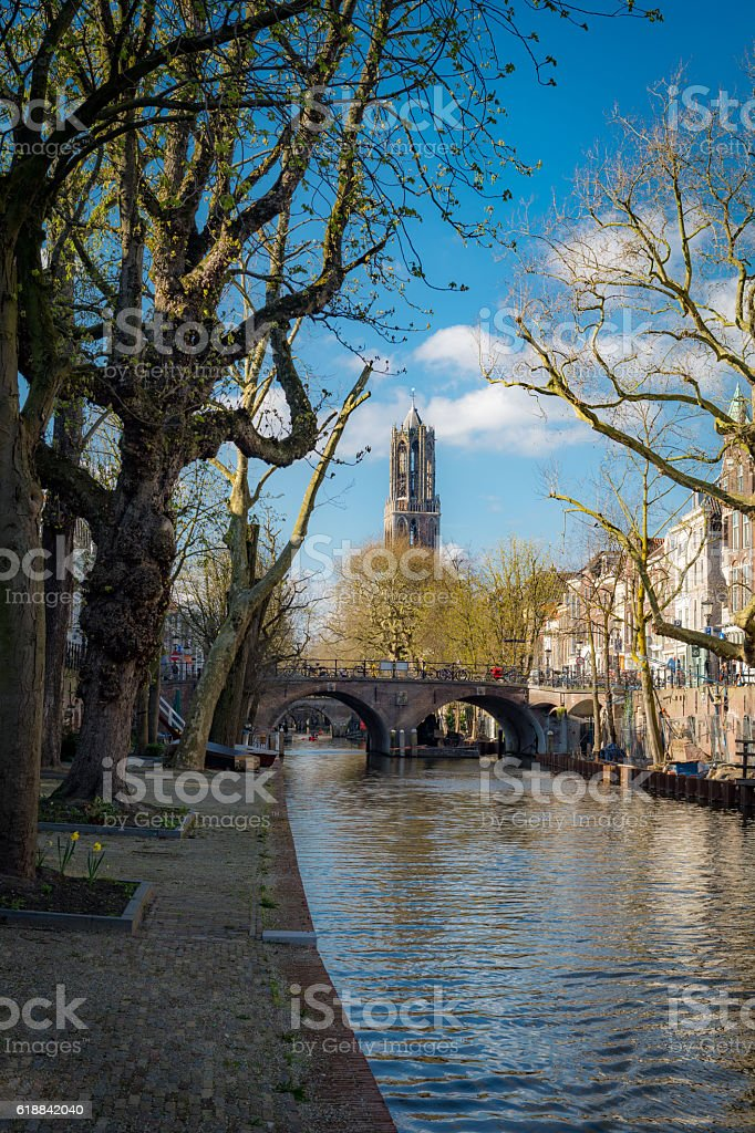 Sunny winterday canals in dutch Utrecht with view on dom stock photo